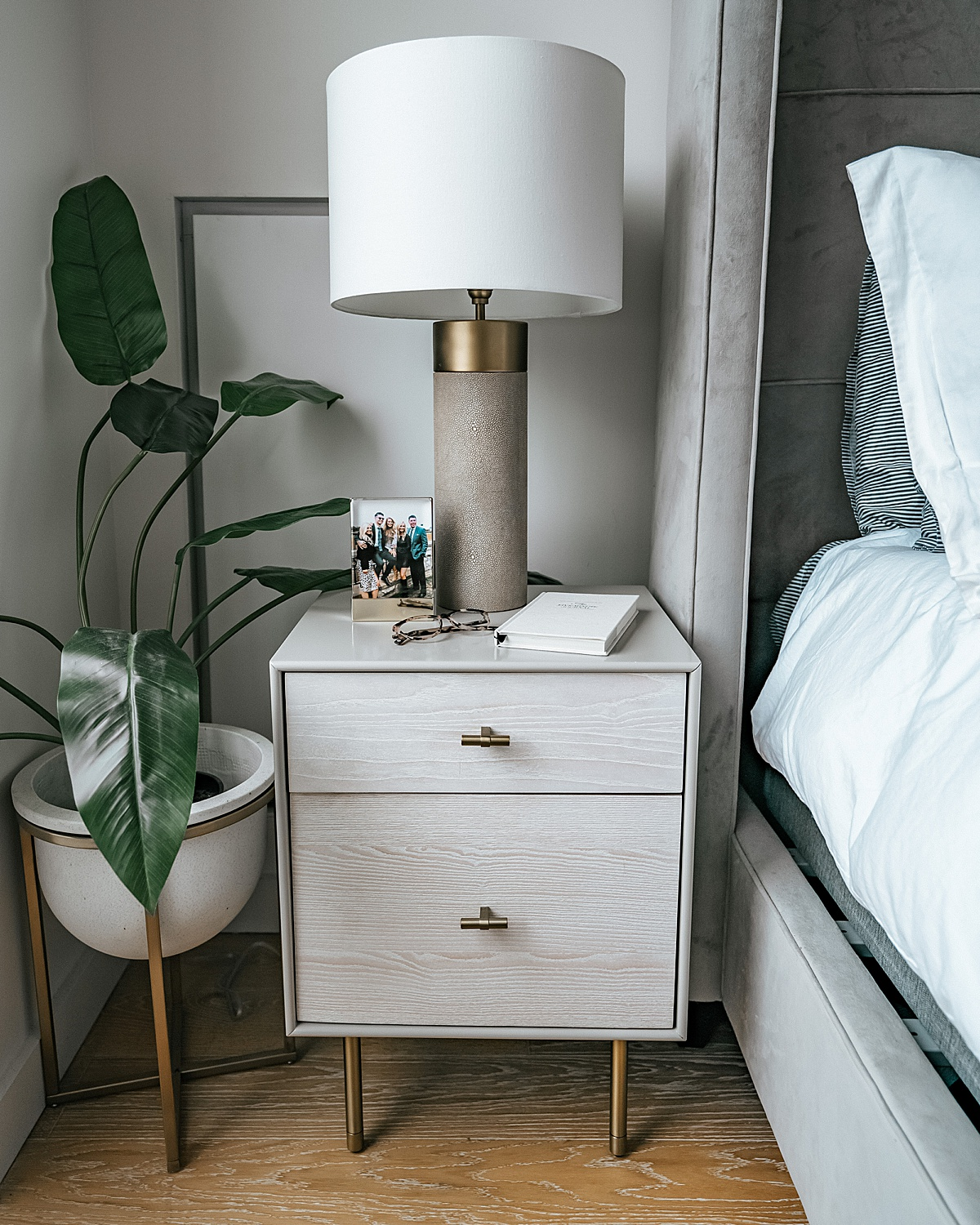 west elm night stand, shagreen lamp, bedroom plant, fake plant, shagreen lamp, nyc apartment, home decor tips, affordable home decor, olivia rink bedroom, olivia rink apartment, olivia rink bedroom, affordable decorating, new york life, new york apartment, nyc living, west elm, kathy kuo home, home decor, bedroom decor, frame, bedside frame, gold frame